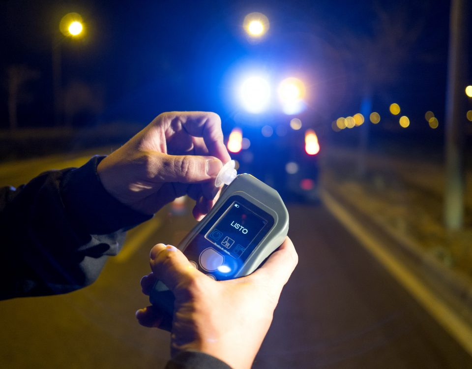 Police giving alcohol test to drunk driver