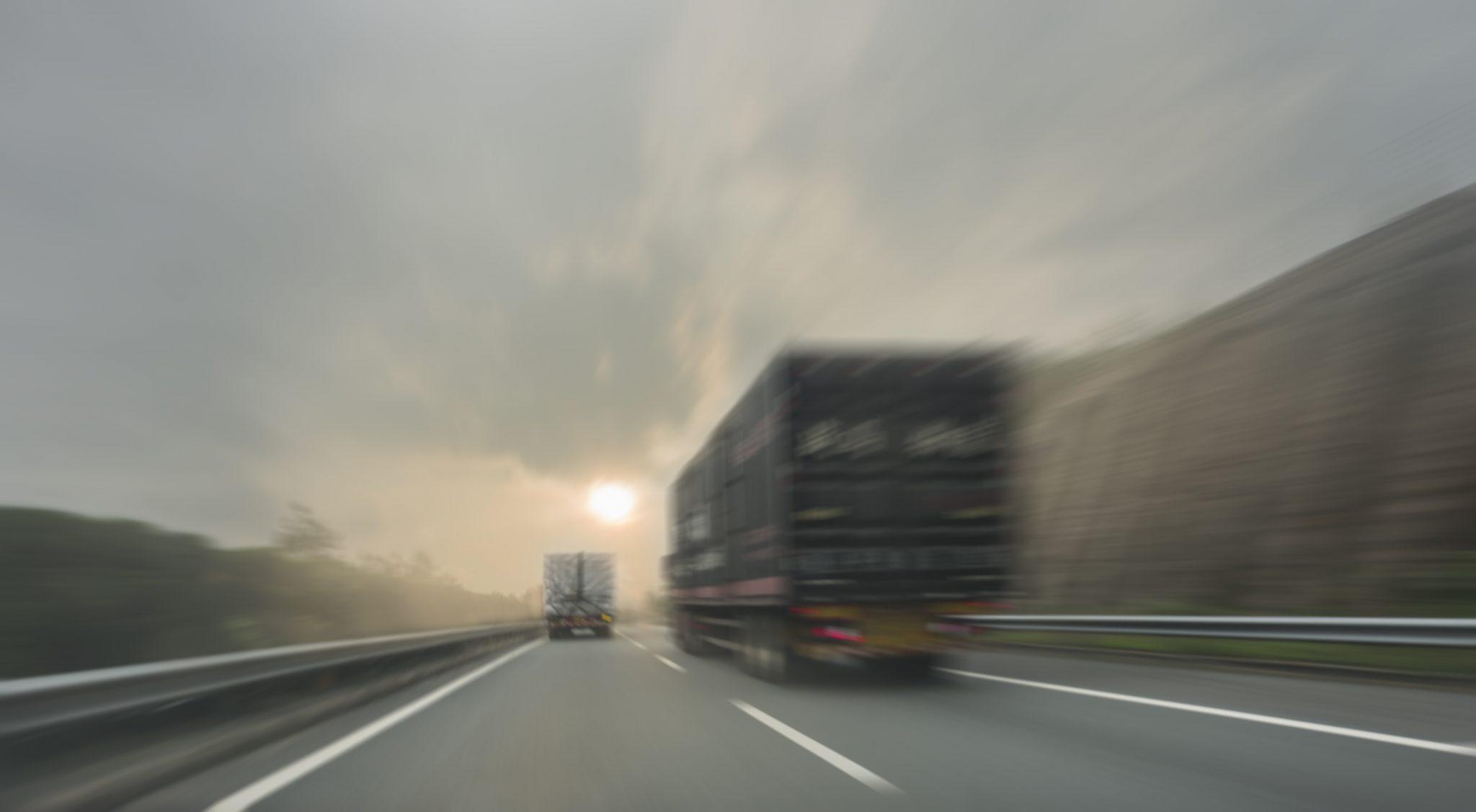 commercial trucks driving