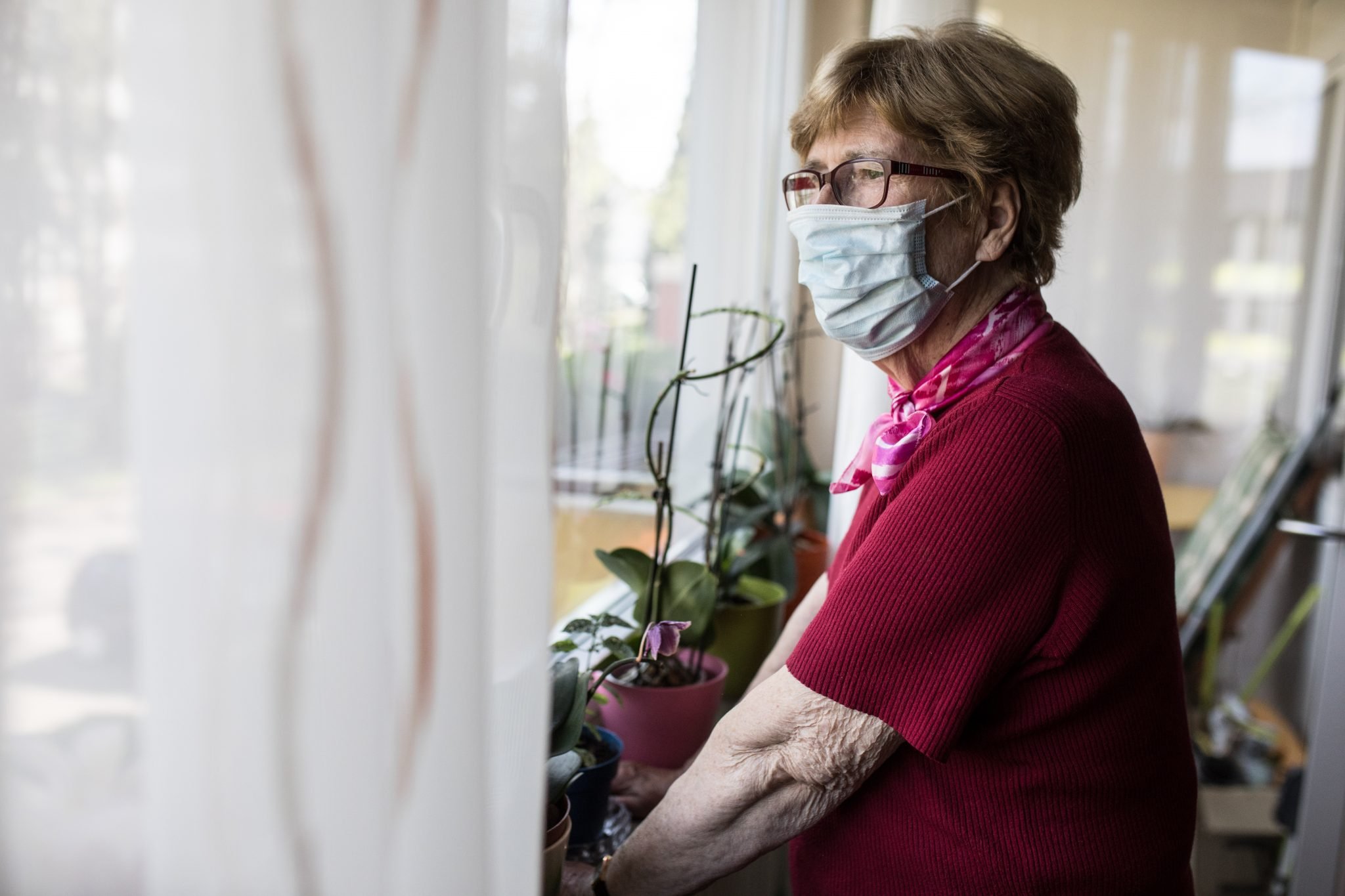 elder woman in nursing home wearing a mask